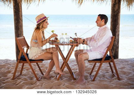 Couple Eating Lunch At The Beach