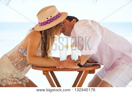 Good Looking Couple Kissing At The Beach