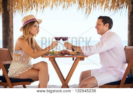 Making A Toast With Wine At The Beach