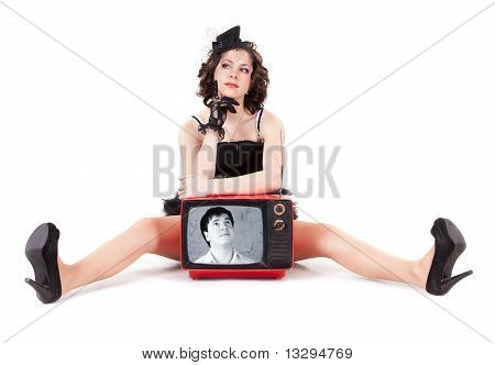 Young Man Looking On The Beautiful Girl Through Old Tv Tube