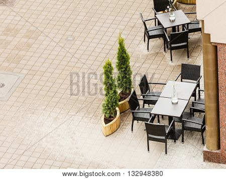 Food service urban bar local dinner concept. Empty restaurant garden. Bistro furniture on the street.