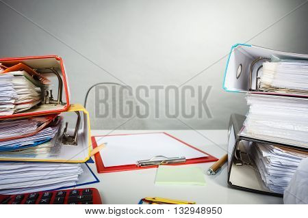 Job work furniture documents concept. Office desk littered with papers. Bureau desk papers calculator.