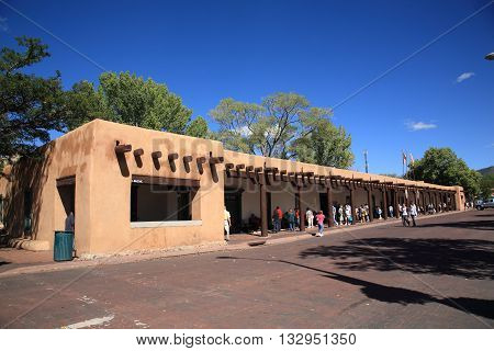 SANTA FE, NEW MEXICO - SEPTEMBER 23: Shoppers & tourists at the Native American market on September 23, 2010 in Santa Fe, New Mexico. The market is held at the Palace of the Governors, built in 1610.
