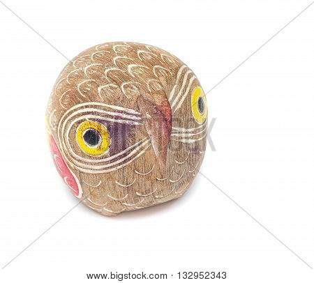 Old wooden carved Owl head boyhood or girlhood toy on white background.