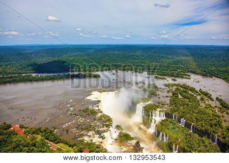 Devil's Throat - largest waterfall of the Iguazu Falls. Iguazu River spreads widely among the dense tropical forests. Picture taken from a helicopter