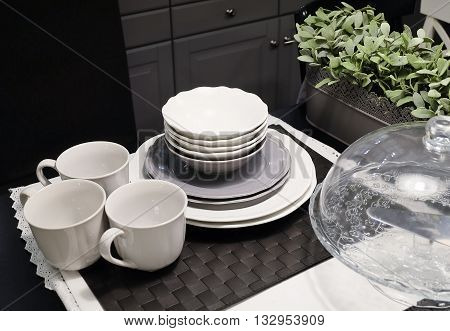 Kitchen Utensil Table Set of Ceramic Dishes Bowls Plates and and Coffee Cups Preparing for Serve Hot and Cold Food.