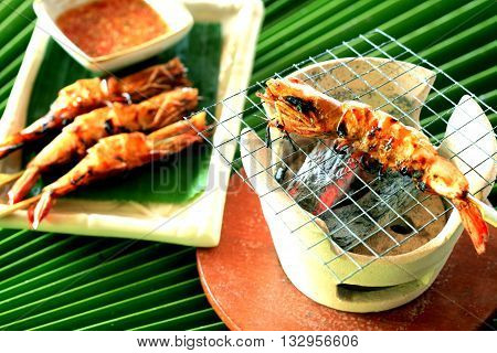 grilled shrimp on skewers with sauce, Thai Hotel Luxury food.