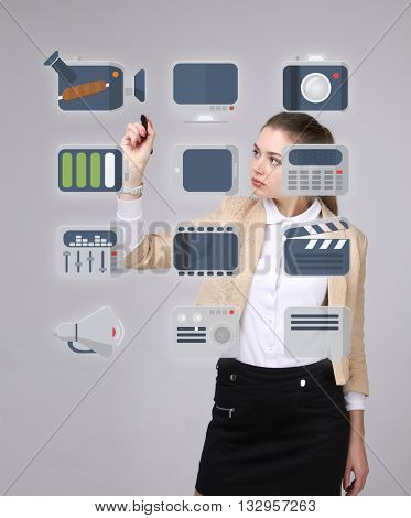Woman pressing multimedia and entertainment icons on a virtual background