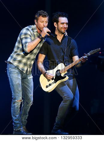 NEW YORK-JUN 26: Country musician Dierks Bentley (L)performs onstage at the 2015 FarmBorough Festival - Day 1 at Randall's Island on June 26, 2015 in New York City.
