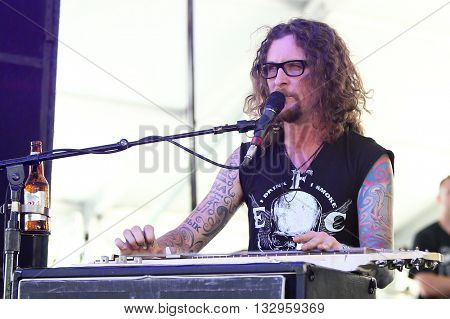 NEW YORK-JUN 26: Country musician Kelby Ray of The Cadillac Three performs onstage at the 2015 FarmBorough Festival - Day 1 at Randall's Island on June 26, 2015 in New York City.