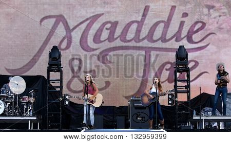 NEW YORK-JUN 26: Country musicians Taylor Dye (L) and Madison Marlow of Maddie & Tae perform onstage at the 2015 FarmBorough Festival - Day 1 at Randall's Island on June 26, 2015 in New York City.