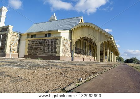 Burra, South Australia, Australia - June 4 2016: The historic site of the Old Burra Railway Station which was newly restored and reopened in March 2015 now used as a Bed and Breakfast and tourist destination. Seen from the bottom right hand corner.