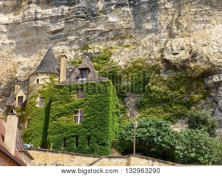Vine-covered buildings line the cliffs of France's La Roque-Gageac
