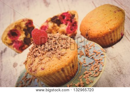 Vintage Photo, Baked Muffins With Raspberries And Grated Chocolate On Wooden Background, Delicious D