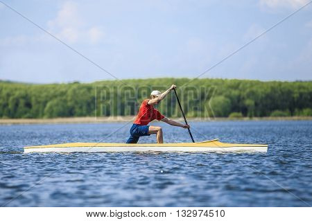 Chelyabinsk, Russia - May 28, 2016: man rower in a canoe rowing across lake during Ural championship in rowing