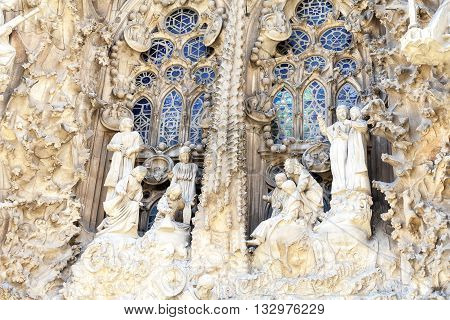 BARCELONA SPAIN - MAY 13 2016 : Details of Sagrada Familia church designed by Spanish architect Antoni Gaudi. Catholic church still built since March 1882 is a combination of Gothic style and curvilinear Art Nouveau forms.