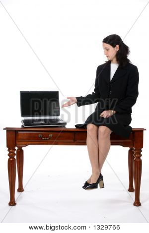 Pretty Business Woman Sitting On Desk With Laptop (Ss)