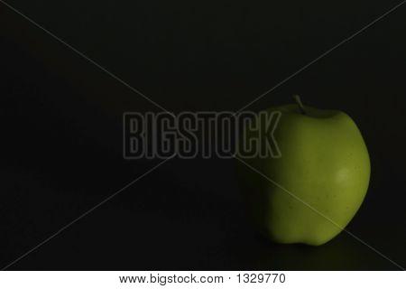 Single Green Apple Side Light Over Black
