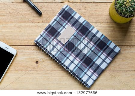 Spiral notebook or ring binder book on wooden table.
