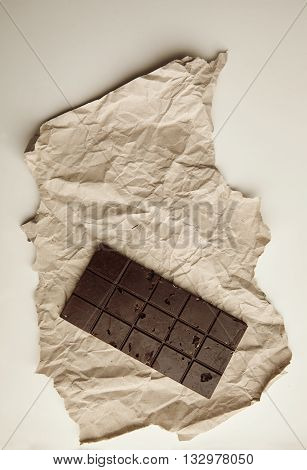 Freshly Baked Rustic Healthy Chocolate Bar With Nuts On Craft Paper, Isolated On White Table On Side
