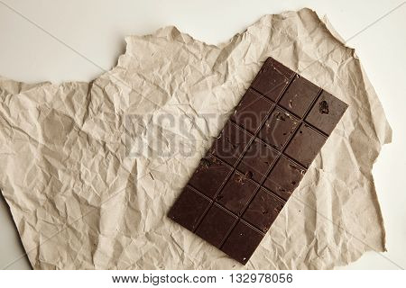 Freshly Baked Organic Healthy Chocolate Bar With Nuts On Craft Paper, Isolated On White Table On Sid