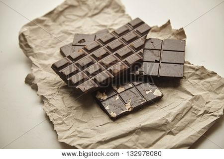 Closeup On Three Different Rustic Chocolate Bars Freshly Baked With Oats, Nuts And Cacao Beans, On C