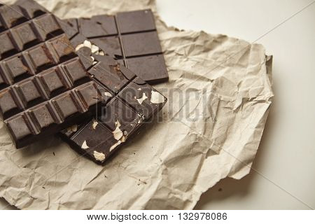 Close Focus On Three Different Rustic Chocolate Bars Freshly Baked With Oats, Nuts And Cacao Beans,