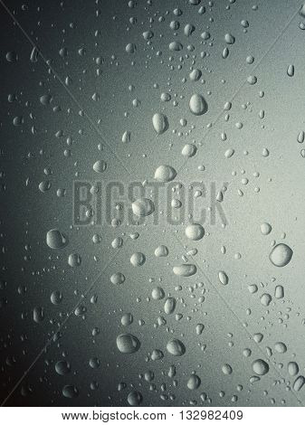 Water droplets on vehicle body part after raining vintage effect