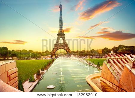 Paris. Eiffel Tower and fountain at Jardins du Trocadero at sunrise, Paris, France. Beautiful Romantic background