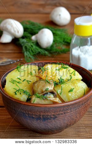 Potatoes and mushrooms cooked in slow cooker. Vegetarian mushroom and potato stew recipe. Green dill, mushroom, fork, salt shaker. Delicious vegan lunch, dinner. Closeup. Rustic style. Vertical photo