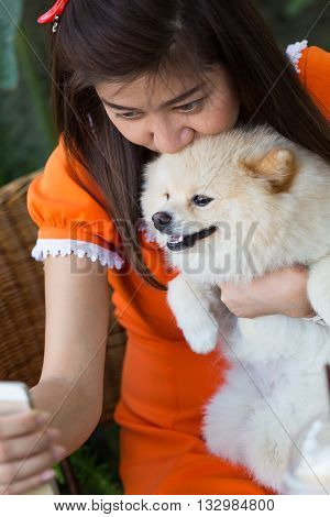 women using mobile phone selfie with pomeranian dog cute pets