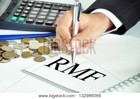 Businessman Hand With Pen Pointing To Rmf (retirement Mutual Fund) Sign On The Paper