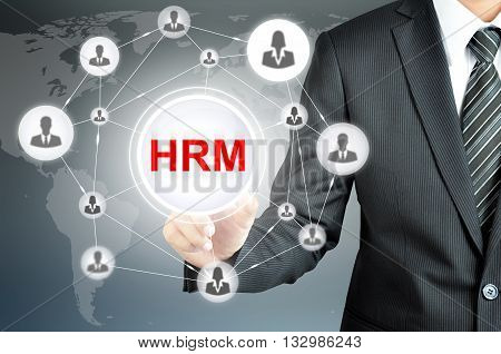 Businessman Pointing On Hrm (human Resource Management ) Sign On Virtual Screen With People Icons Li