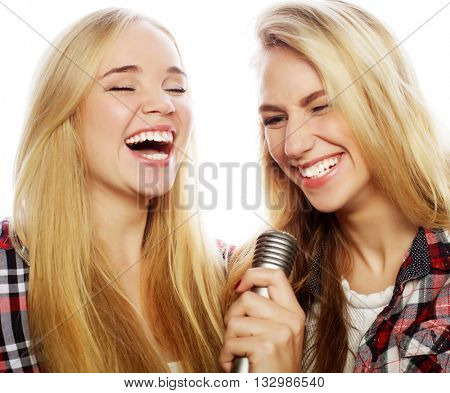 two young hipster girls singing