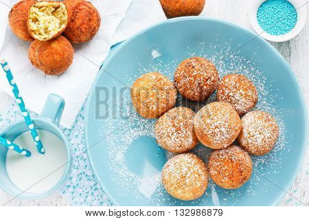 Delicious donuts sprinkled with icing sugar top view
