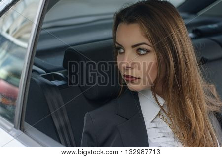 Girl In Formal Clothes Rides In A Car