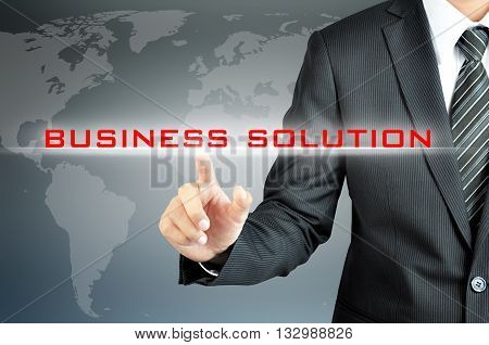 Businessman hand touching BUSINESS SOLUTION sign on virtual screen