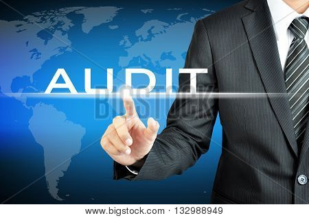 Businessman Touching Audit Sign On Virtual Screen