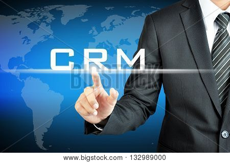 Businessman Pointing To Crm (customer Relationship Management) Sign On Virtual Screen