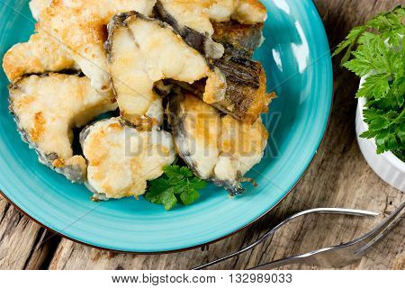 Fried fish sea rabbit (chimera fish sea rat) on wooden table top view