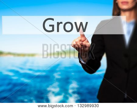Grow - Businesswoman Hand Pressing Button On Touch Screen Interface.