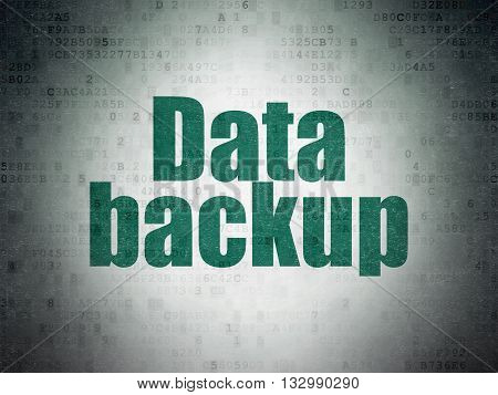 Information concept: Painted green word Data Backup on Digital Data Paper background