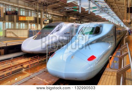 Osaka, Japan - May 11, 2016: Shinkansen trains at Shin-Osaka Station. The station is the terminus of the high-speed Tokaido and Sanyo Shinkansen lines