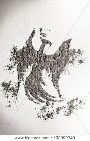 Phoenix eagle bird shape drawing in ash as life and death symbol
