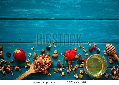 Granola ingredients. Granola food background on blue wooden table. View from above with copy space.