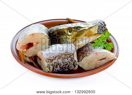 Pieces of pike fish on a plate isolated on white background