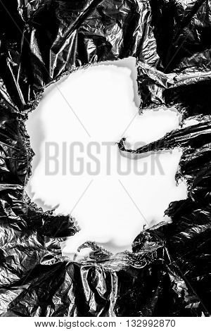 Round plastic black material garbage bag background