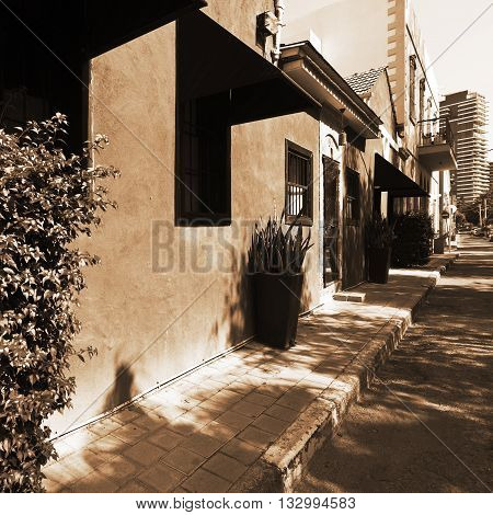 Old Houses after Reconstruction in Tel Aviv on the Background of the Modern Building Vintage Style Sepia