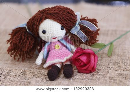 Baby doll made with knitting wool sit on sackcloth