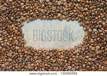 Coffee beans background with oval space for text top view